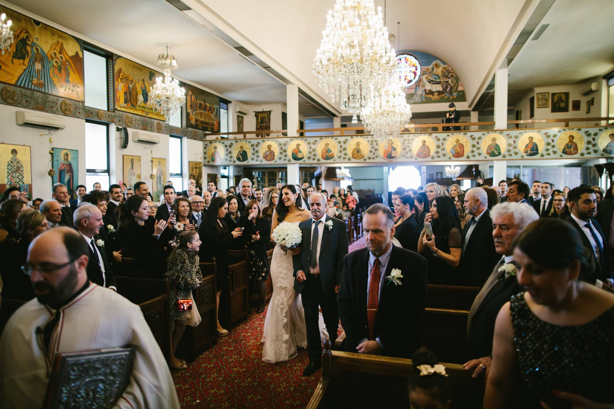 dad walking the bride down the aisle at a grek wedding in melbourne - best greek wedding photographer - large scale weddings