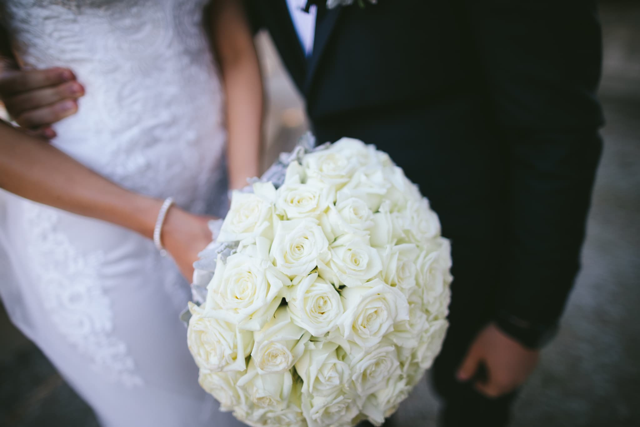 white flowers (roses) at wedding