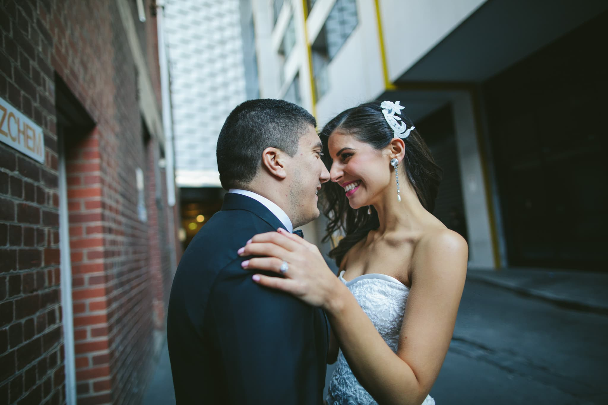 love in the city - bride and groom hug in melbourne cbd