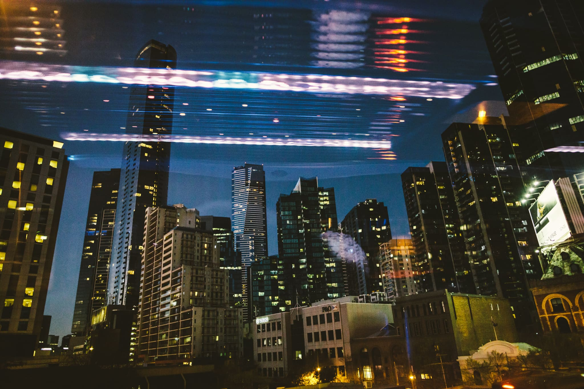 melbourne skyline photographed from hummer limo at wedding - creative shot with reflections