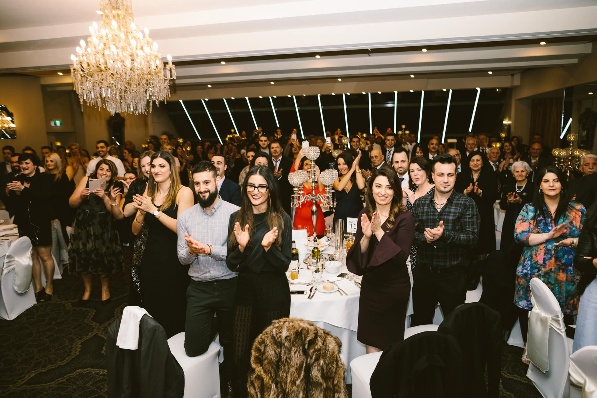 crowd cheering at wedding party
