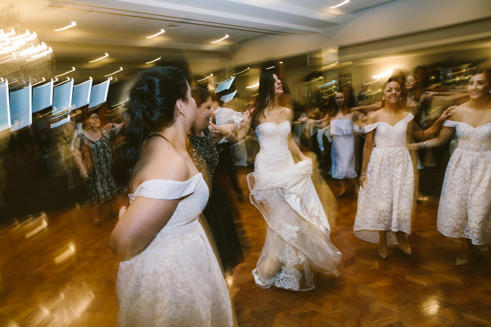 bride and bridesmaids rock the dancefloor