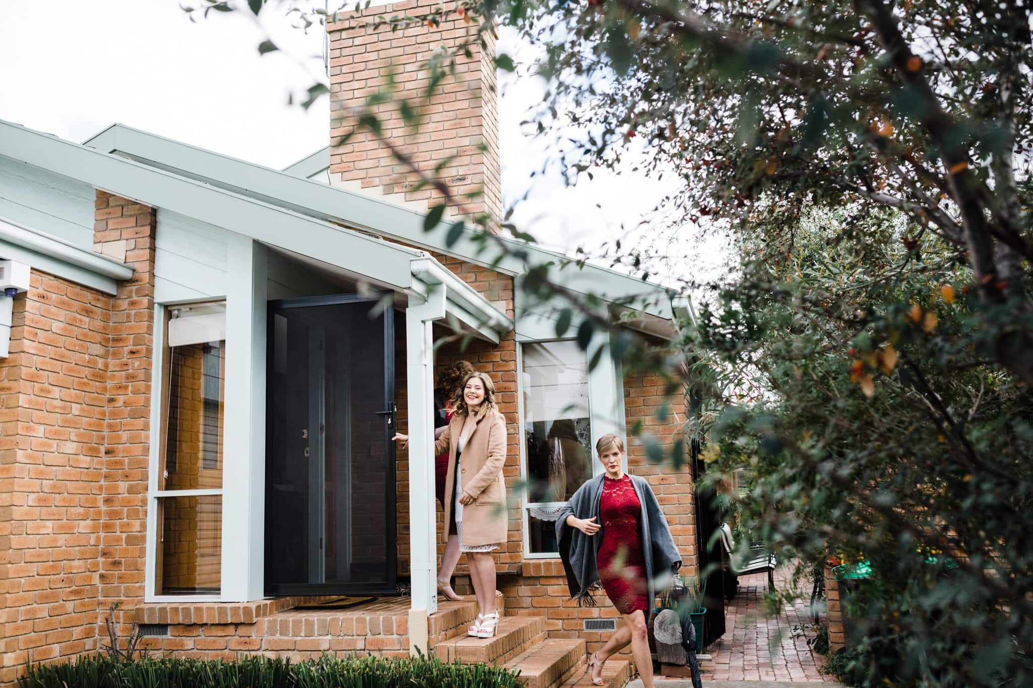 photojournalistic wedding photos - documenting the day - bride leaves the house in melbourne