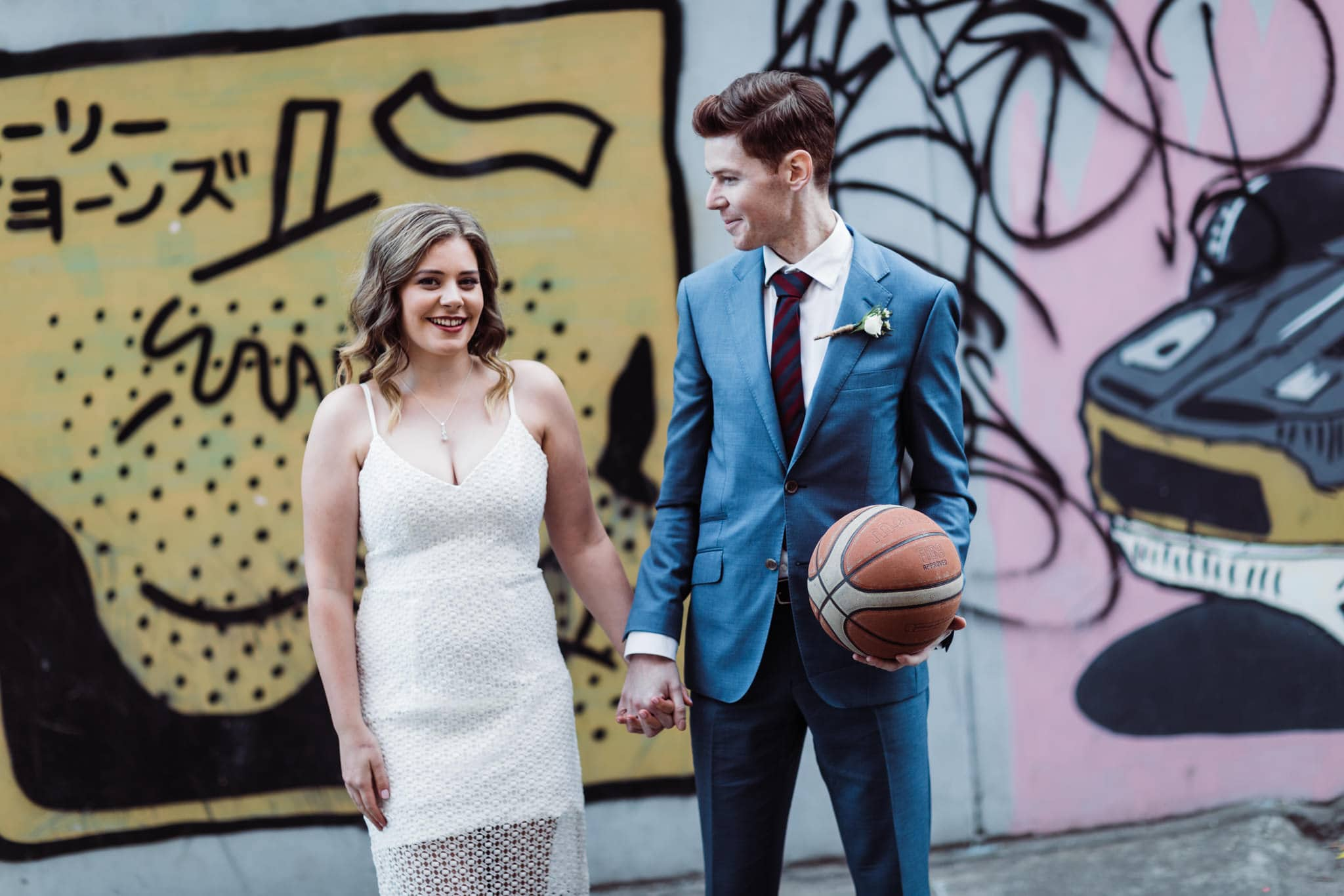 bridal couple playing basketball sports at wedding - candid wedding documentation by mellbourne photographer - rad and relaxed photos