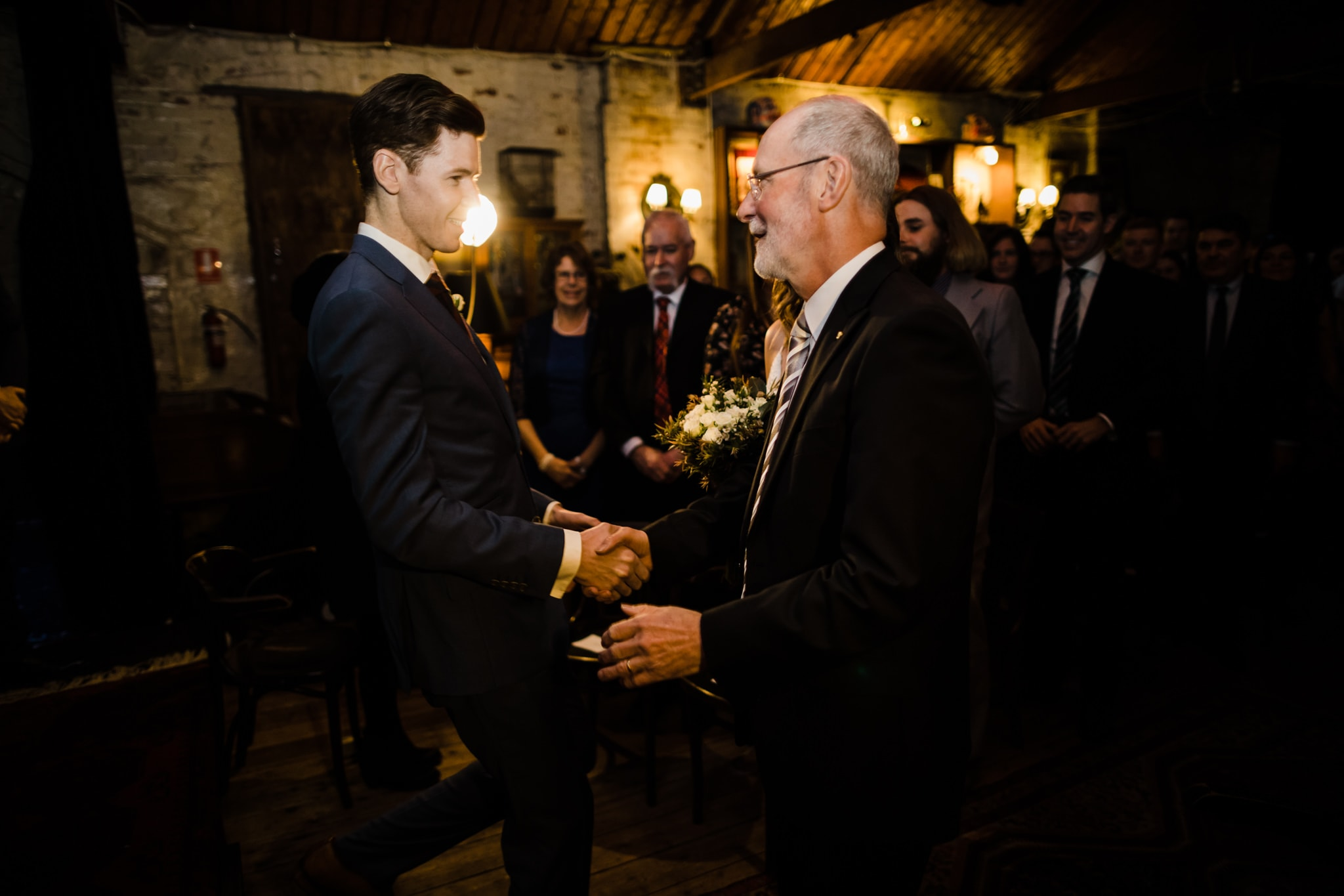 father welcomes the groom - moments of a wedding