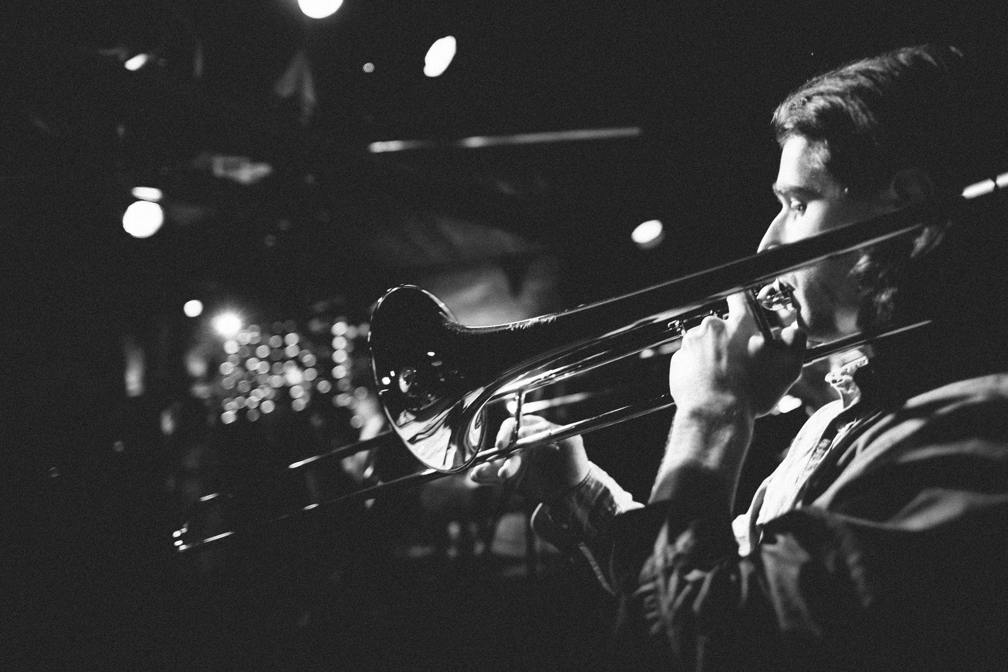 photographers captures candid shots of wedding in melbourne - music band at wedding playing trumpet