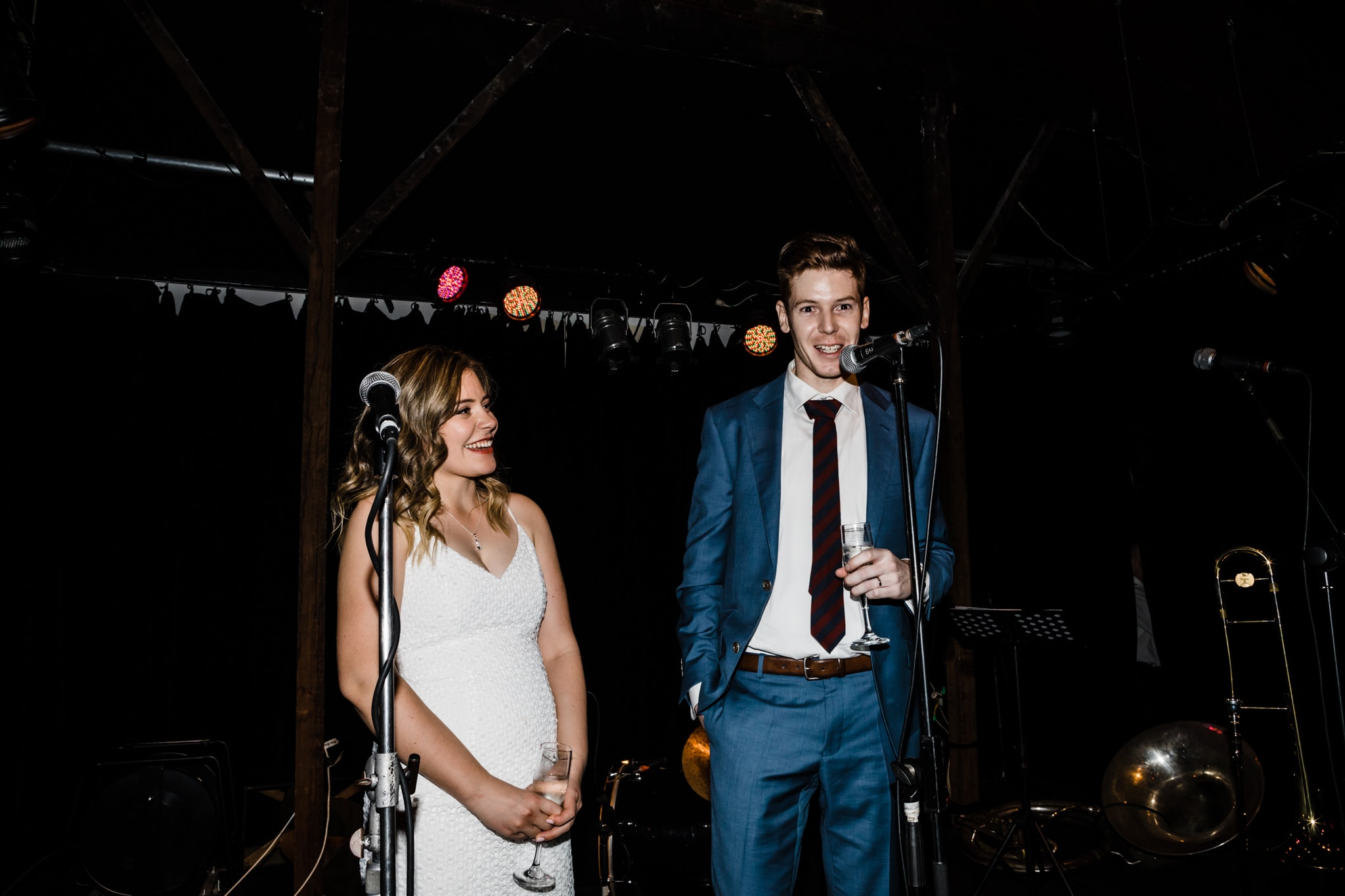 bride and groom giving their speech on stage at a wedding in melbourne
