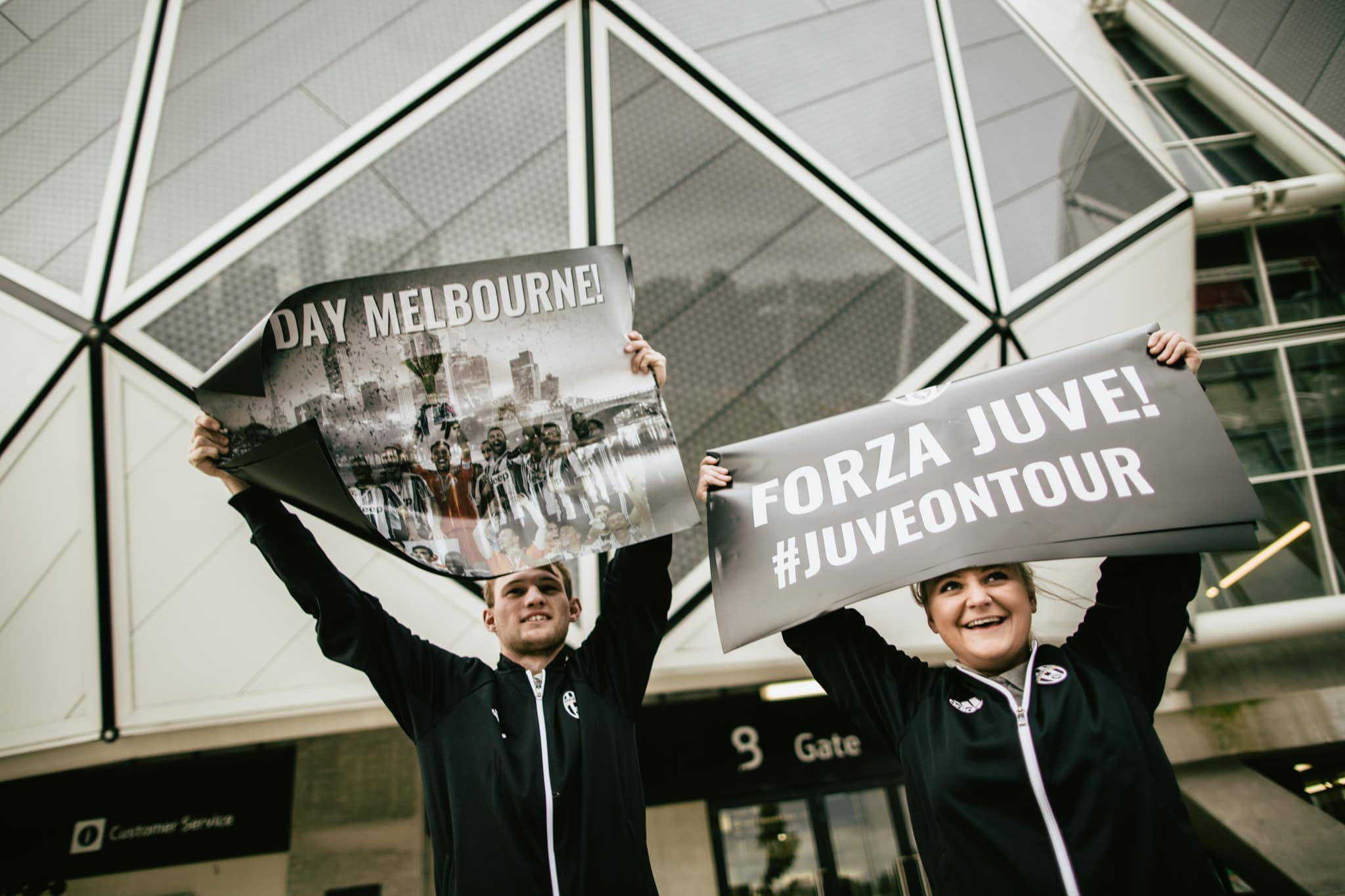 juventus fans in front of stadium with posters