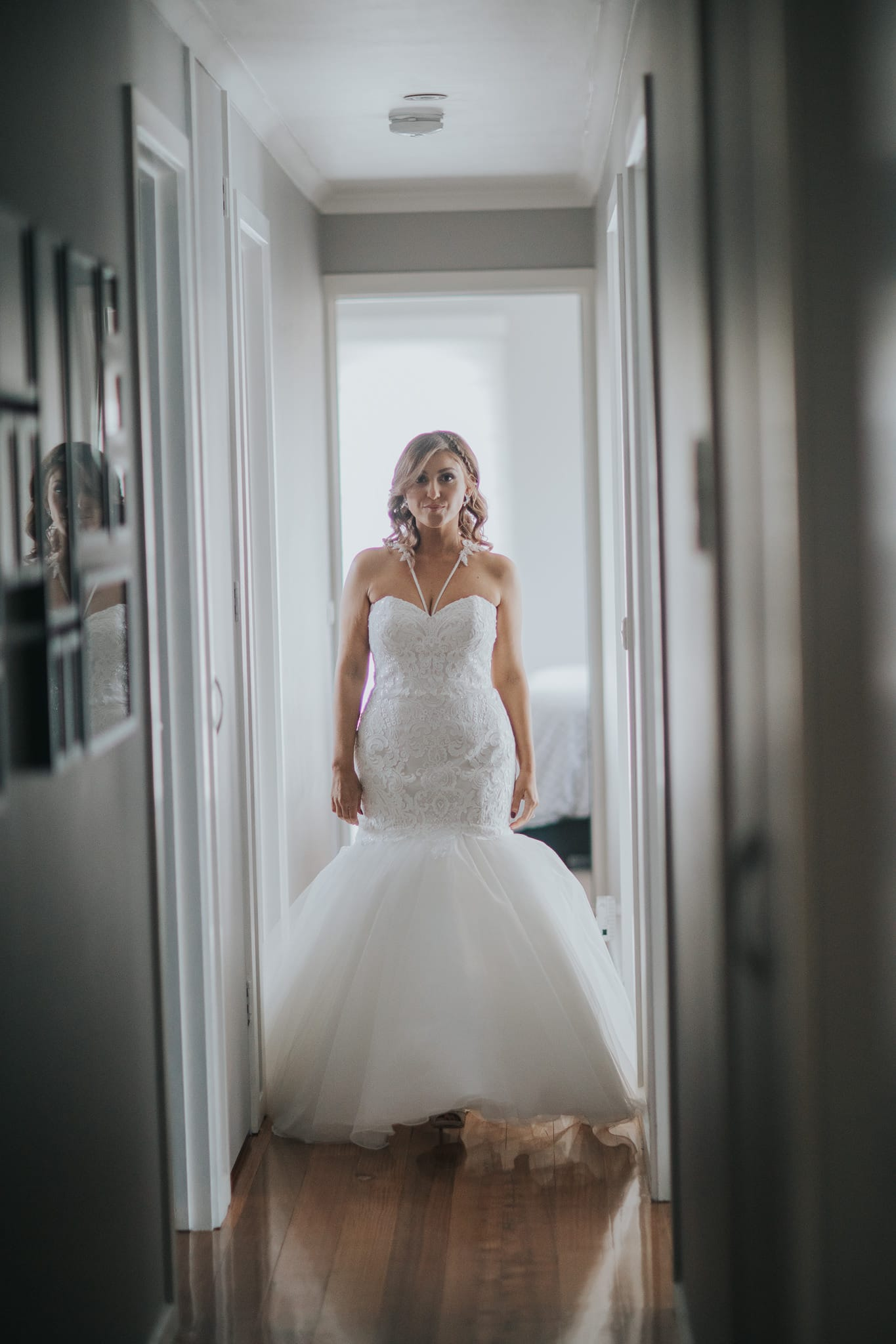 bride walking from her room to meet the father