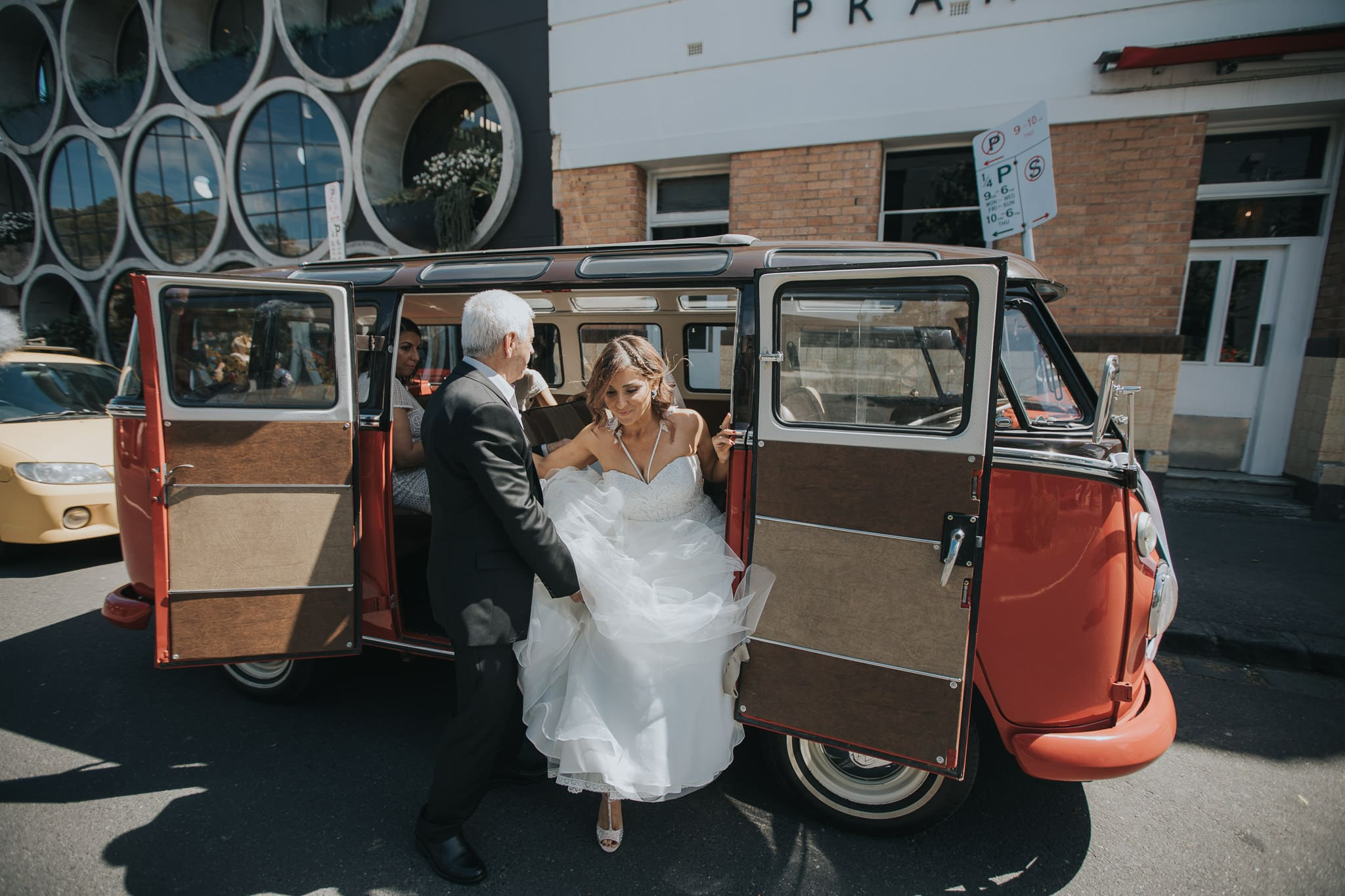 Bride gets out of the car - father helps the bride
