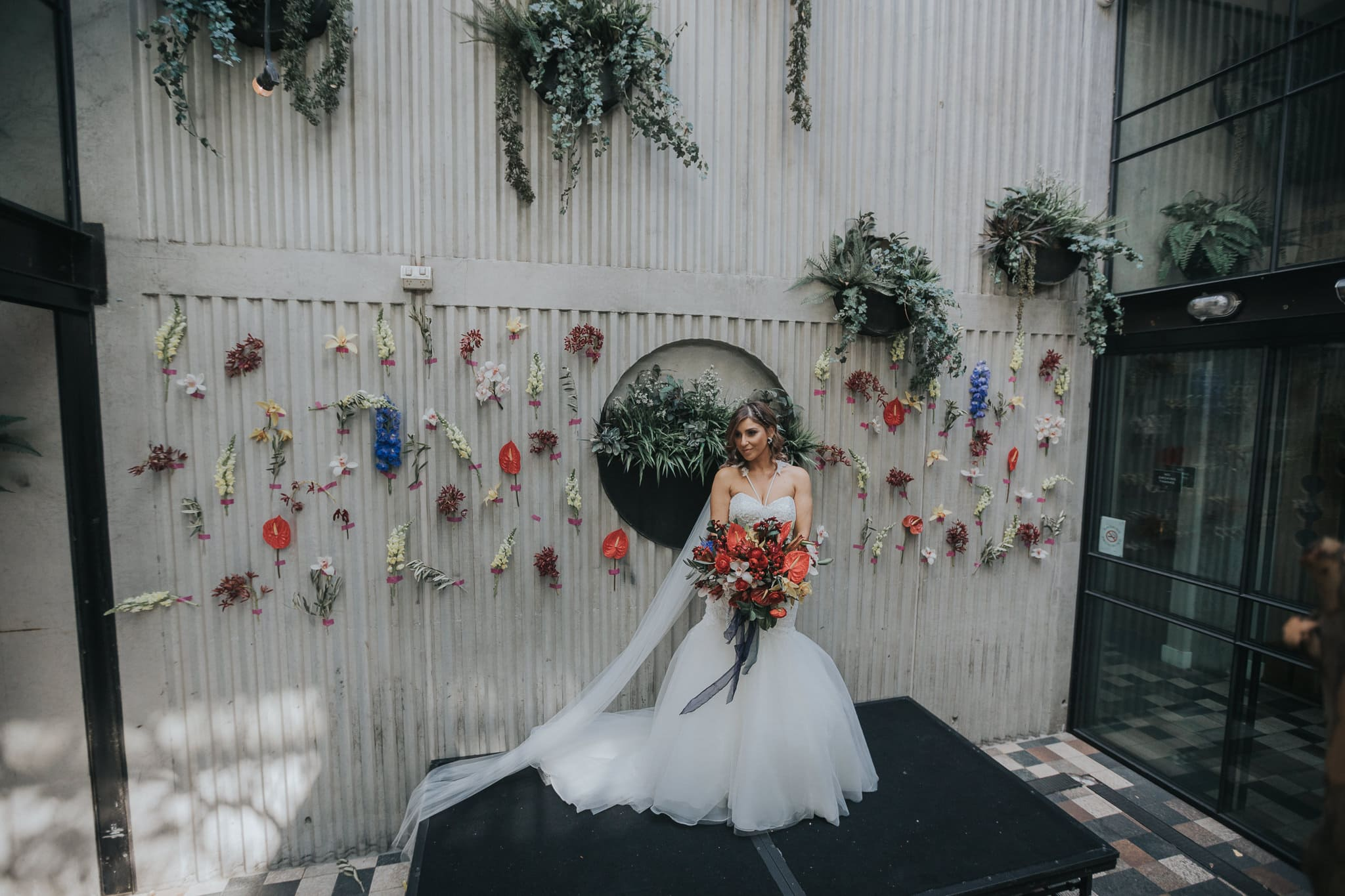 beautiful bride with contemporary flower backdrop