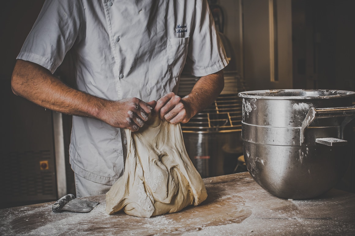 commercial bakery photography - kneading