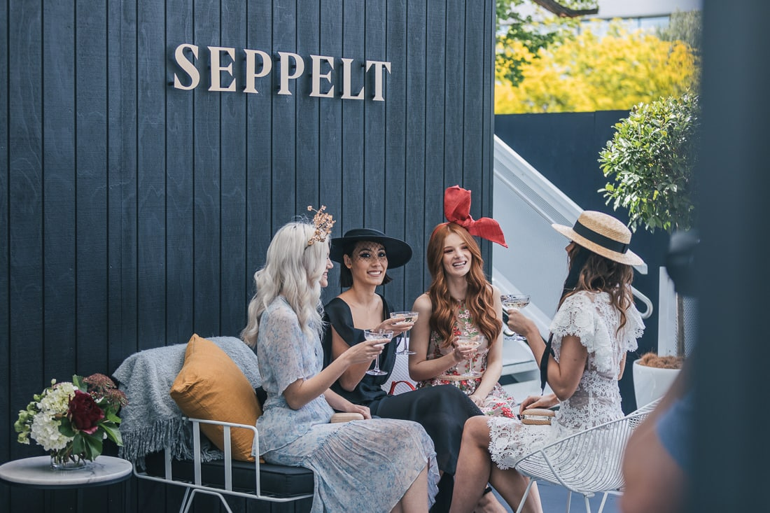 girls relaxing at event with prosecco - seppelt