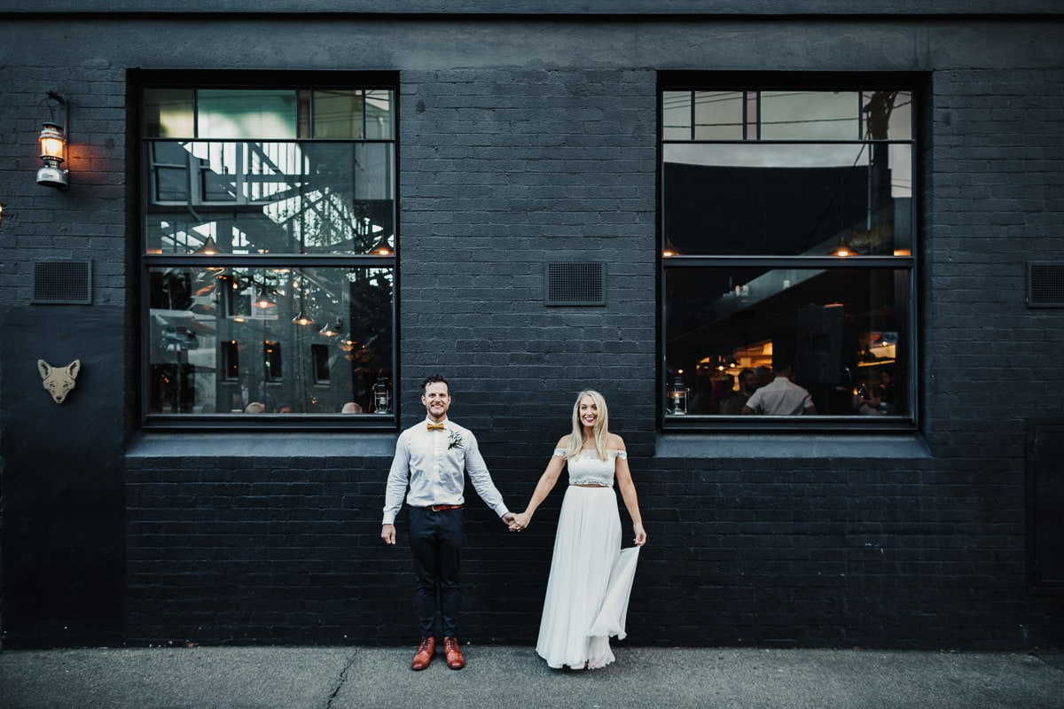 Beautiful couple infront of venue - captured by Melbourne Photographer in Abbotsford