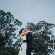 How to find the right wedding photographer? Couple dancing at outdoor party with fairy lights