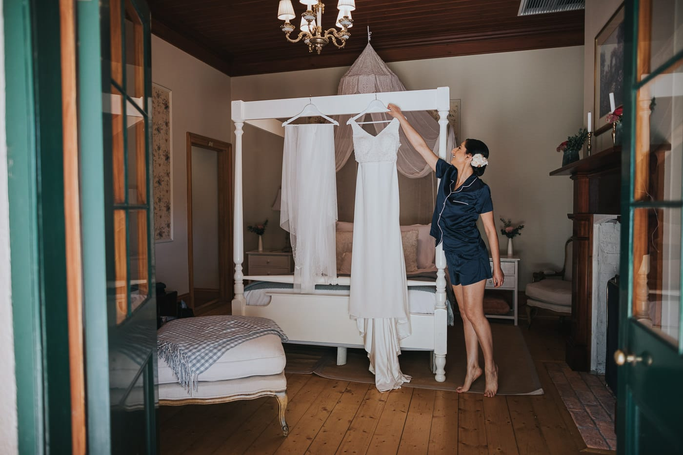 bride getting the wedding dress in the bridal suite at Flowerdale Estate - Wedding Photography at Flowerdale Estate