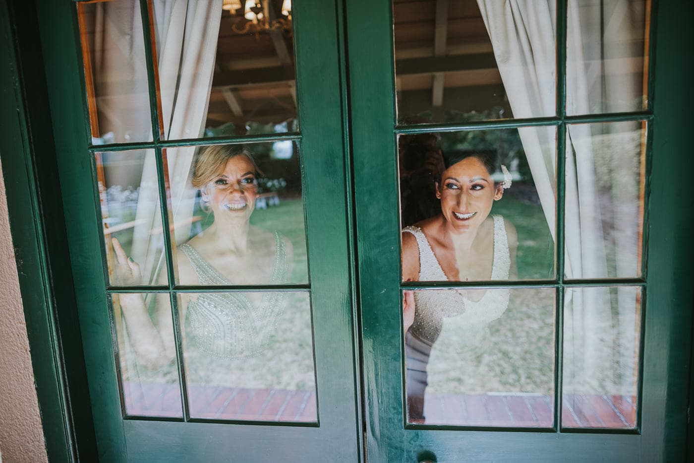 Yarra VAlley Wedding Photos - Bride and maid of honour looking out of window
