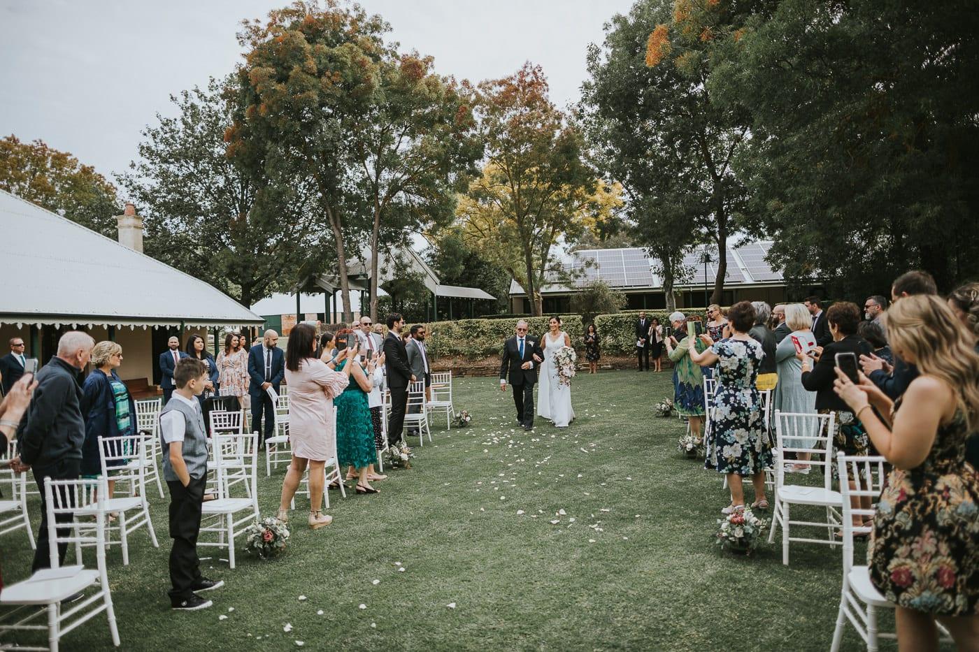 Ceremony in the gardens of flowerdale estate in strath creek - Country Victoria Garden Wedding