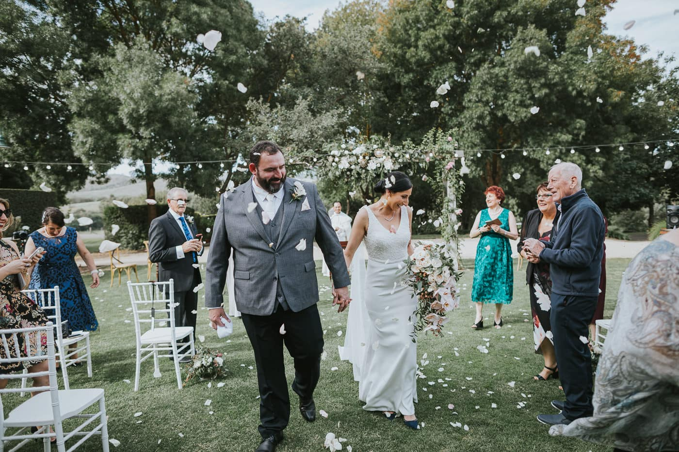 throwing rose petals after ceremony at flowerdale estate - Wedding photographer captures moments and emotion at wedding