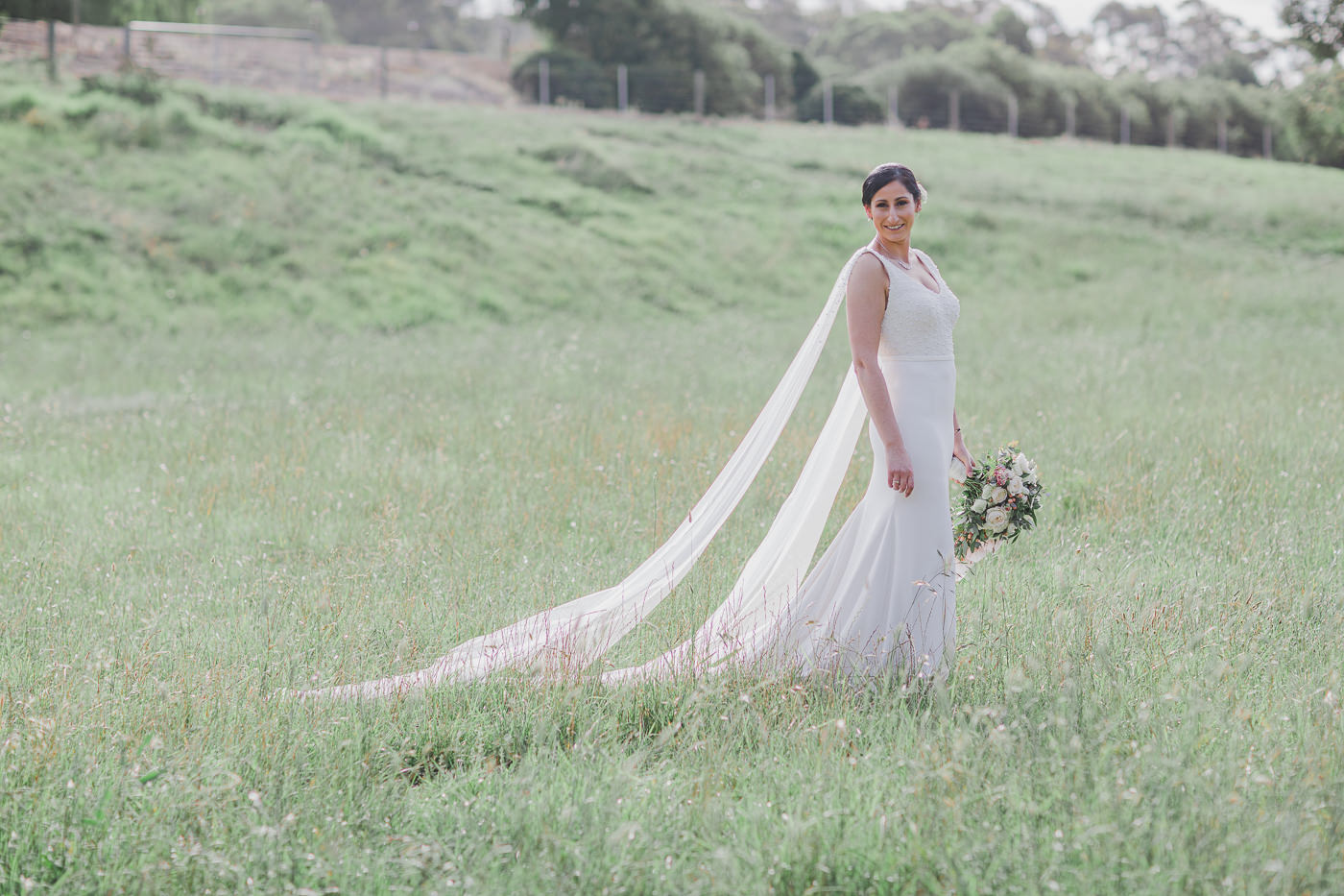Beautiful bride on the fields around Flowerdale Eastet - Photographed by Wedding Photographer