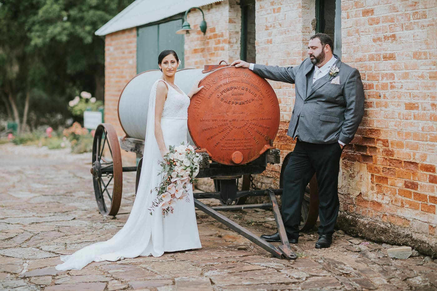 Country Victoria Wedding Photos - Wedding phootgraphy at Flowerdale Estate - Furphy Cart with Bride and Groom