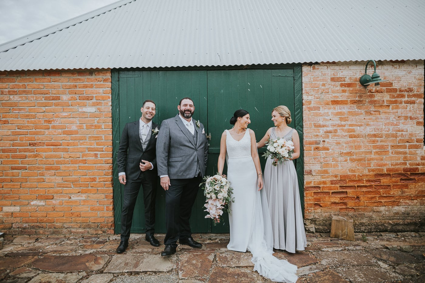Bridal Party infront of rustic door at Wedding at Flowerdale Estate