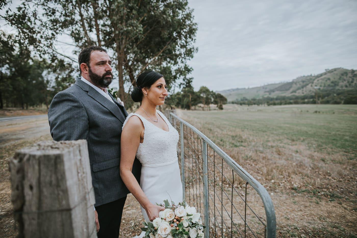 bride and groom overlooking the hills