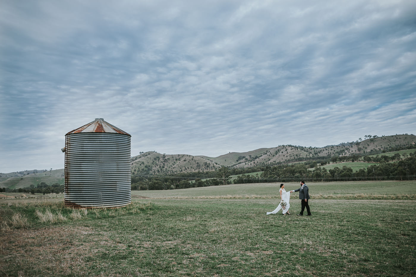 Silo Photography at Flowerdale Estate - Wedding Photographer captures couple on their wedding day in the sweeping hills of Country Victoria