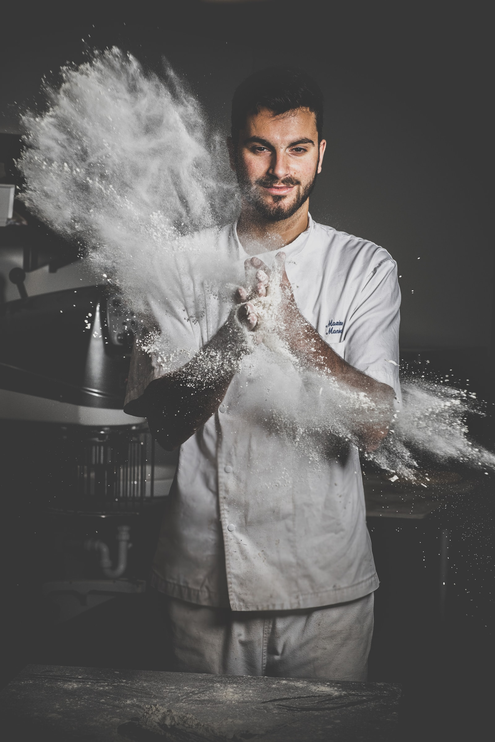 small business photography in Melbourne for bakery - creative portraits of business owner - flour shot